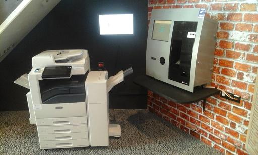 printer en boeken innemen